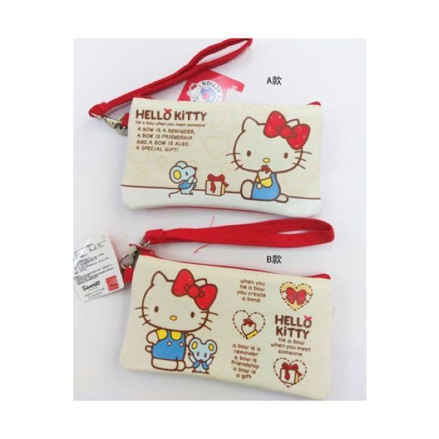 三麗鷗HELLO KITTY凱蒂貓蝴蝶結手提觸控包 收納包 置物包 手機包