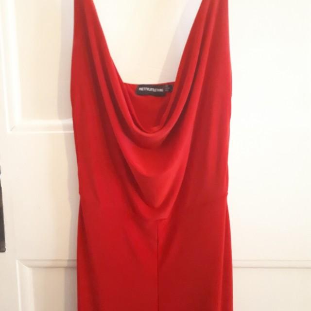 Red flare pants low neck jumpsuit