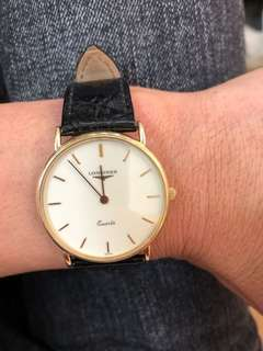 Longines 18k solid gold