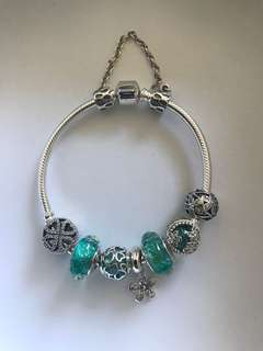 925 sterling silver bracelet with floral motif charms, beads and dangle