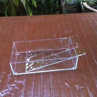 Brand new never used yet transparent plastic tissue box.