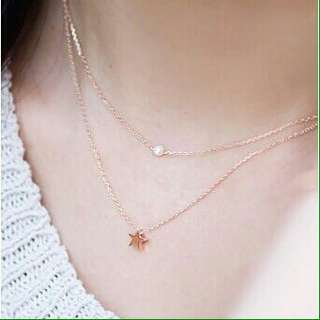 Pearl and star layered necklace