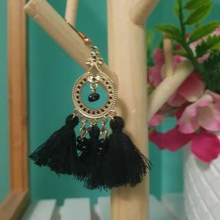 Black and gold circle tassel earrings