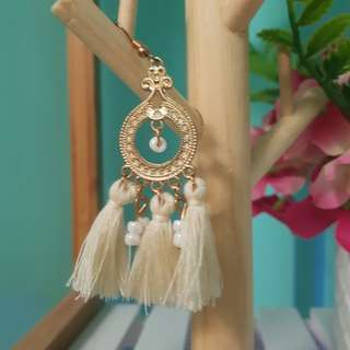 White and gold circle tassel earrings