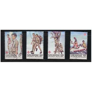 SINGAPORE 1982 75TH ANNIV. WORLD SCOUT MOVEMENT COMP. SET OF 4 STAMPS SC#404-407 IN FINE USED CONDITION