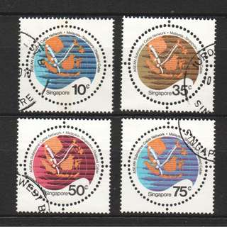 SINGAPORE 1983 COMPLETION OF ASEAN SUBMARINE CABLE NETWORK COMP. SET OF 4 STAMPS SC#426-429 IN FINE USED CONDITION