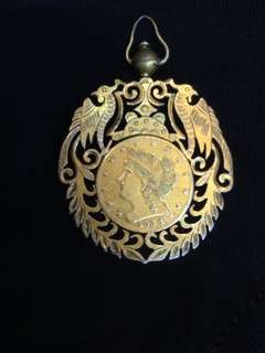Gilt gold pendant