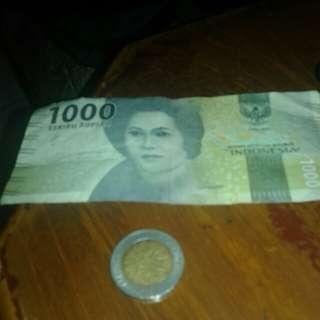 uang coin klapa sawit dan uang kertas seribuan tju tmeutia