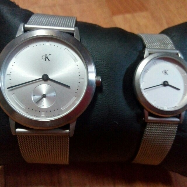 Auth. Ck His and Her Watch