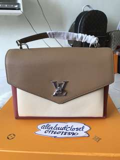 Customer's purchased, LV Lock Me Shoulder Bag