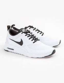 White and black Nike Thea