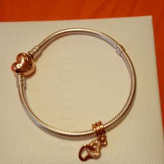 Pandora bracelet with rose gold clasp and rose gold charm.