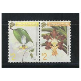 SINGAPORE 1993 ORCHIDS 3RD SERIES SE-TENANT PAIR COMP. SET OF 2 STAMPS IN FINE USED CONDITION