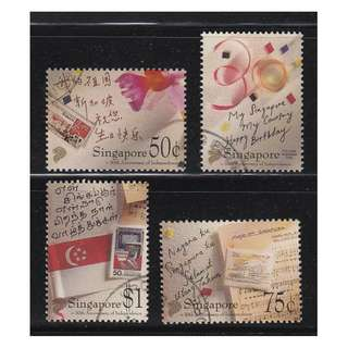 SINGAPORE 1995 30TH ANNIV. OF INDEPENDENCE COMP. SET OF 4 STAMPS SC#718-721 IN FINE USED CONDITION