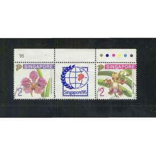 SINGAPORE 1995 ORCHIDS 5TH SERIES SE-TENANT PAIR WITH GUTTER COMP. SET OF 2 STAMPS SC#716-717 IN FINE USED CONDITION