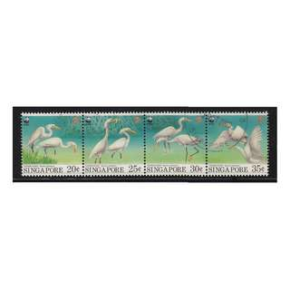 SINGAPORE 1993 WWF MIGRATORY BIRDS CHINESE EGRETS STRIP OF 4 STAMPS COMP. SET SC#673a IN FINE USED CONDITION