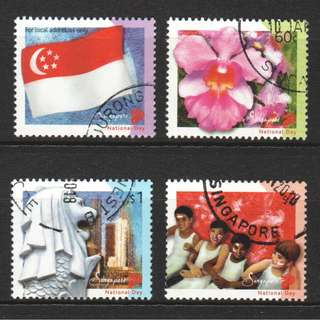 SINGAPORE 2003 NATIONAL DAY (MANY RACES, ONE PEOPLE) COMP. SET OF 4 STAMPS IN FINE USED CONDITION