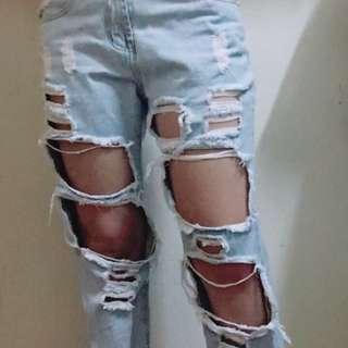 歐美街頭時尚破洞牛仔男友褲