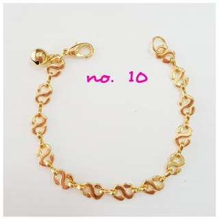 Gold plating pattern bracelet with bell.