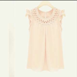 Braided neck top blouse in light peachy pink color