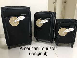 New American Tourister Expandable Luggage Set