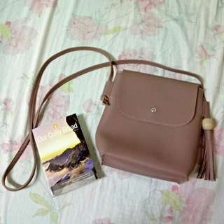 Sling bag with tassle