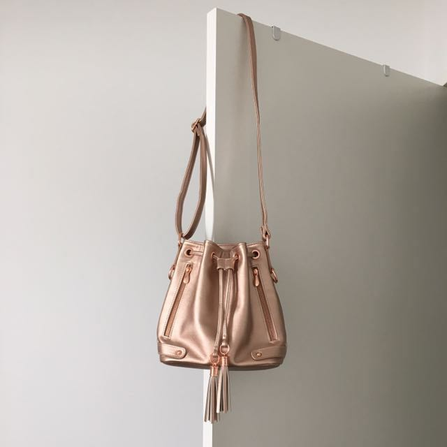 Colette Rose Gold Drawstring Bucket Bag