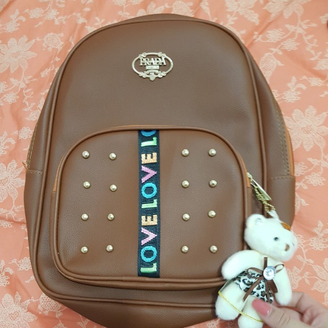 Prada cute brown leather back pack with charm