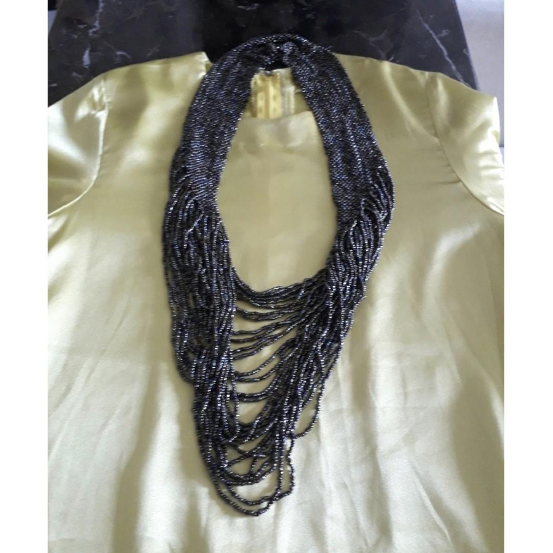 TOM ABANG SAUFI Sarawak beads necklace.