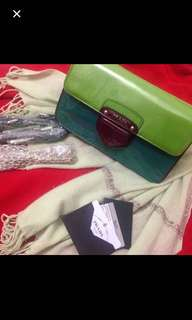 Authenthic Prada patent leather clutch with dust bag