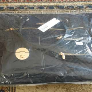 Brand new with tag Colette Hayman black nappy bag quilted gold hardware