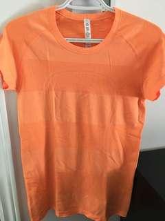 Lululemon tshirt orange size 10- medium