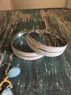 Silver glittery hoop earrings