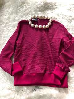 Moschino sharp pink jumper with giant necklace