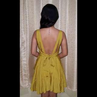 Gold open back dress