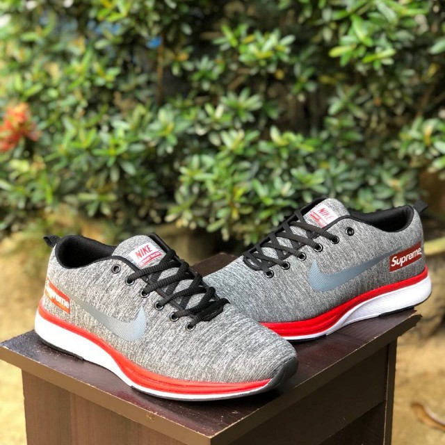 9d8c08f8e6f82 flyknit racer X supreme grey red white