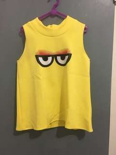 Yellow eye top