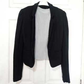 Black blazer with padded shoulders