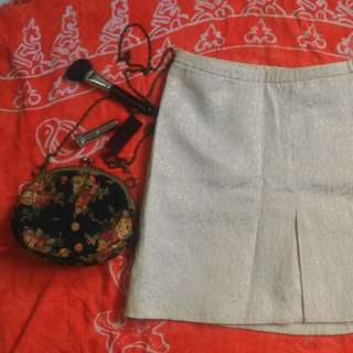 White mini skirt with gold embossed print