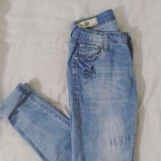 light-washed embroidered denim jeans