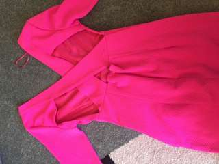 Pink night out dress with cross detail on the back