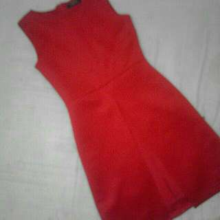 FOLDED AND HUNG RED DRESS