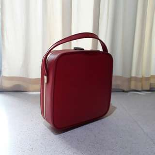 small cute vintage red Paklite cosmetic case