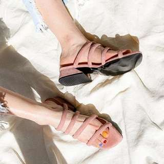 Strappy sandals in peach