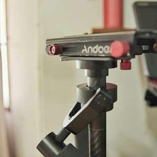 Andoer mini camera carbon fiber stabilizer handheld steadycam