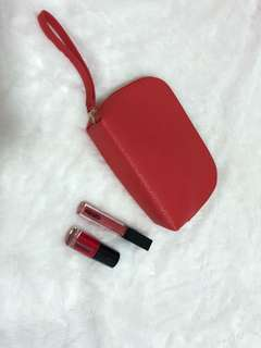 Kenzo lip gloss & nail polish with a red pouch .