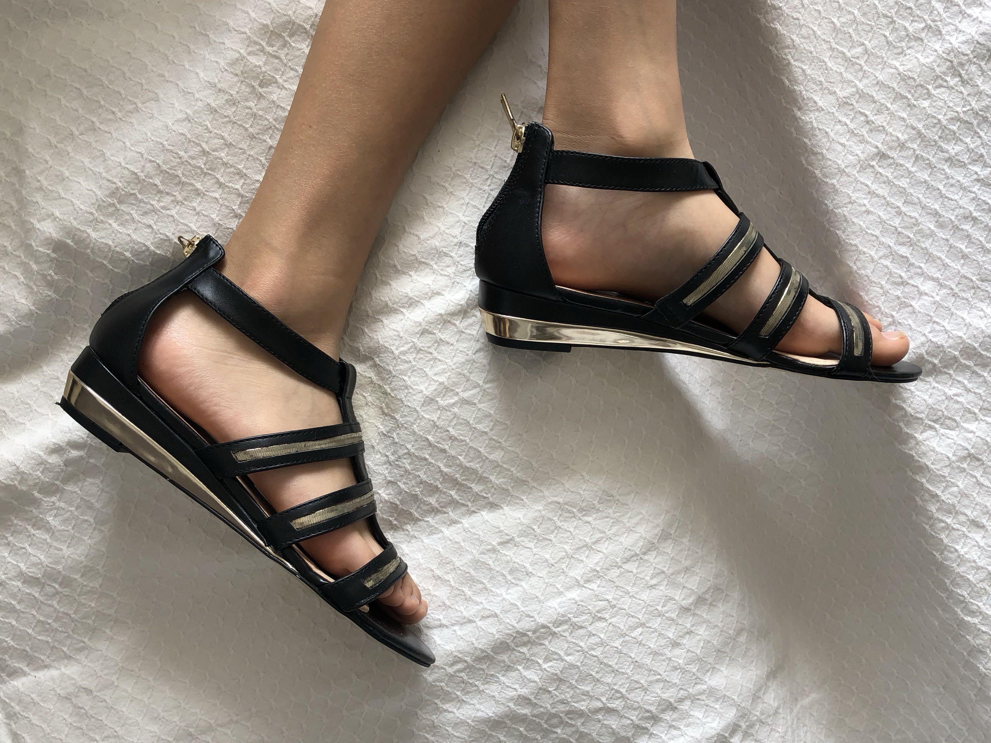 Black slightly heeled sandals with gold detailing