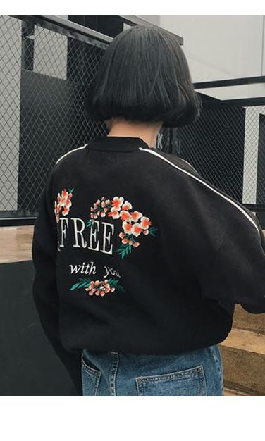 Black sweatshirt / jumper with embroidered flowers and text