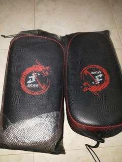 Punching and Kicking muay thai pad