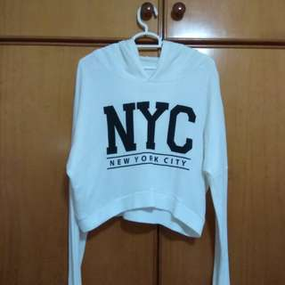 white long sleeved hooded NYC crop top